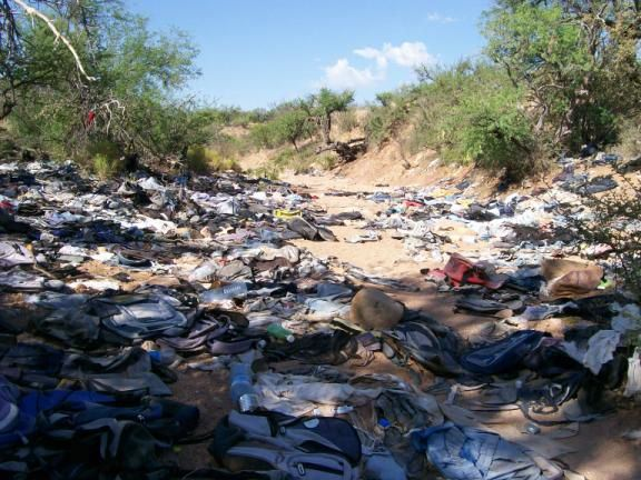 Piles of trash at illegal camp spot