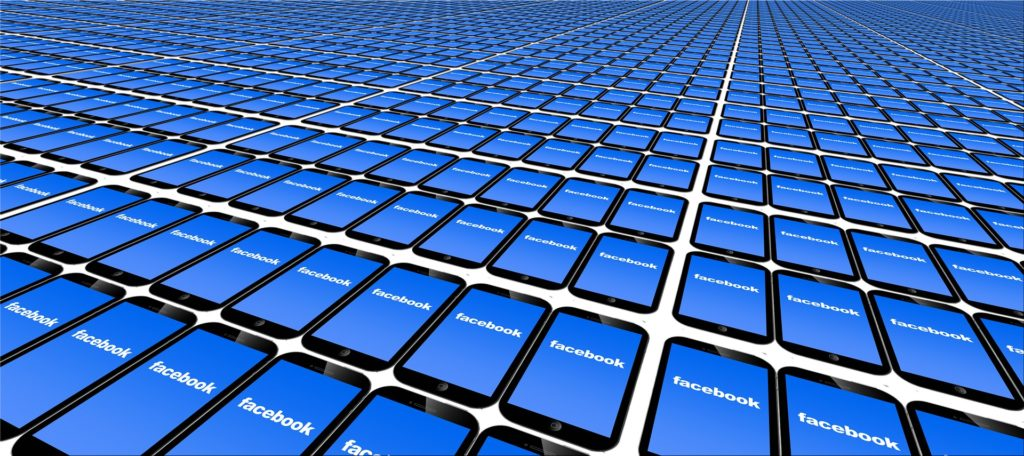 Row upon row of mobile phones, each displaying the Facebook logo.