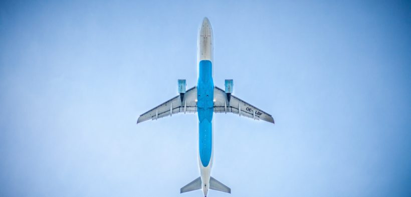 A plane in the air from below.