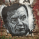 Viktor Yanukovych (painted portrait on a wall.)