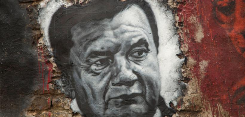 Viktor Yanukovych (painted portrait on a wall.)