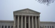 The Supreme Court building from outside on a cloudy day.