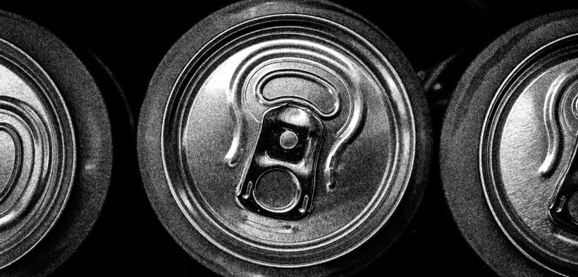 Tops of soda cans in black and white.