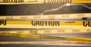 "Yellow tape bearing the word ""CAUTION."""