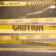 """Yellow tape bearing the word """"CAUTION."""""""