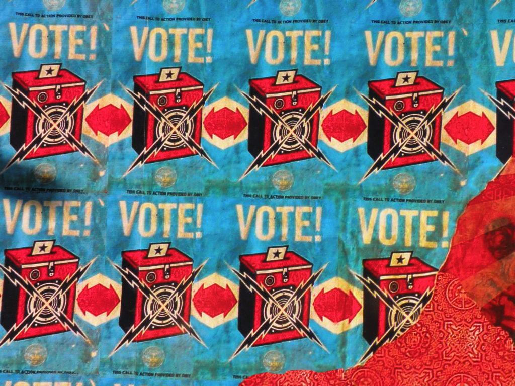 Shepard Fairey street art encouraging people to vote.
