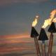 Tiki torches at sunset.