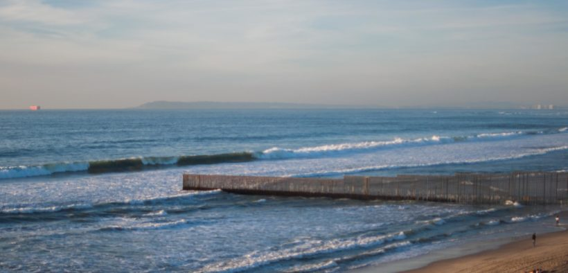 The U.S.-Mexico border wall in Playas, Tijuana, where it extends out into the Pacific Ocean.