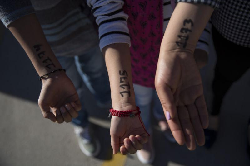 Numbers written on the arms of asylum-seekers waiting to have their cases heard.