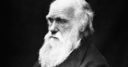Charles Darwin appearing serious.