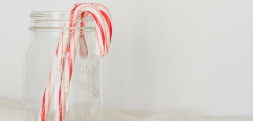 Candy canes in a jar.