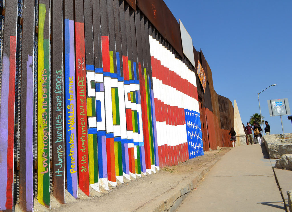 Wall separating the United States from Mexico, showing graffiti from the Tijuana side.