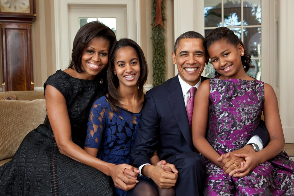 Official portrait of former United States President Barack Obama and his wife and daughters.