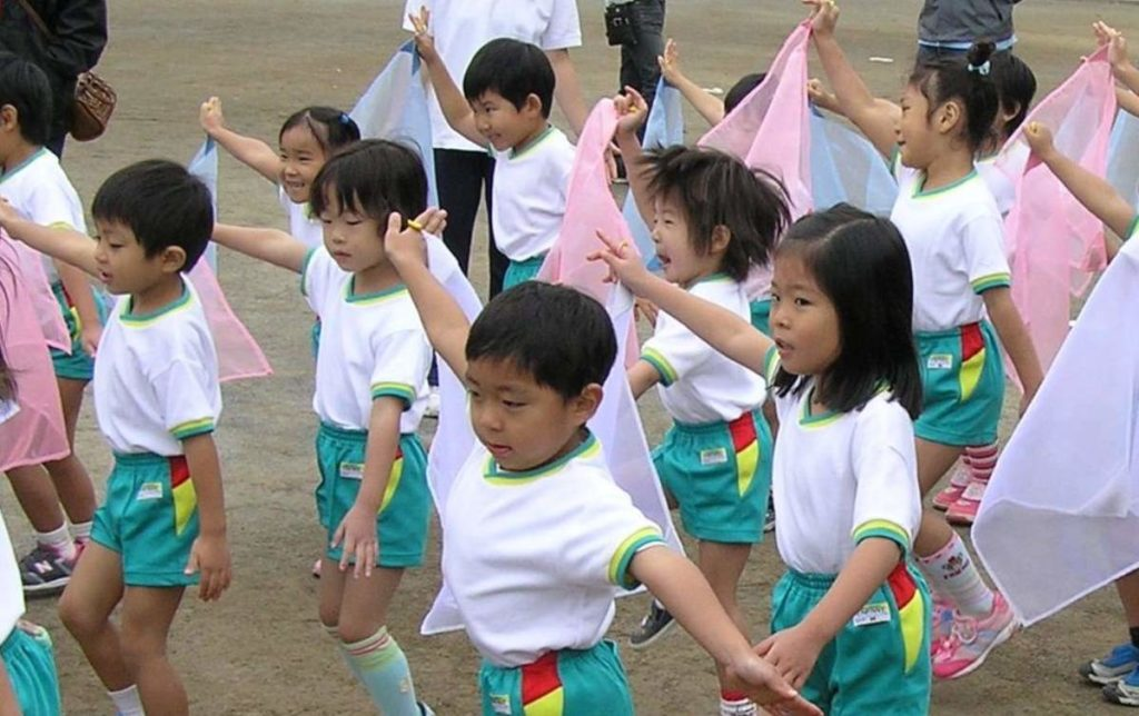 Japanese day care students performing at sports day.